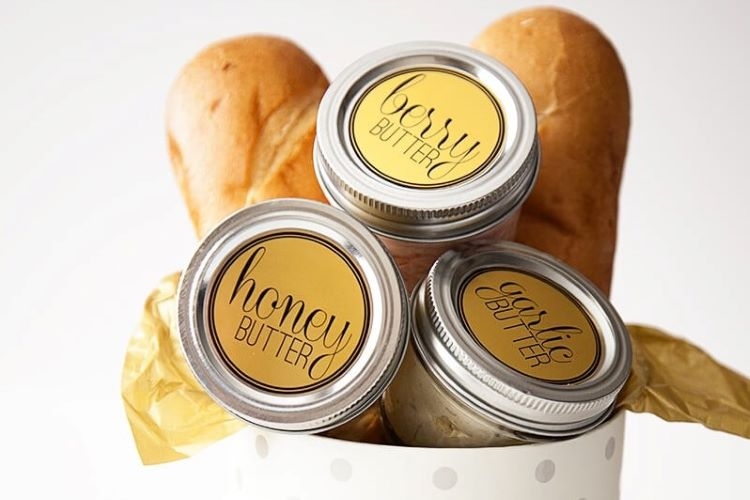 A bread themed gift basket with three jars of flavored butter | The Dating Divas