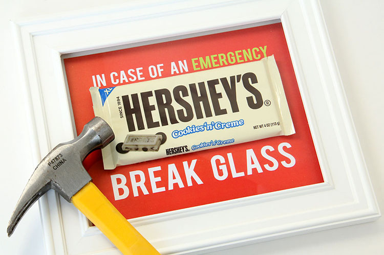 An easy white elephant gift idea to put chocolate in a frame with printable instructions to break the glass in an emergency | The Dating Divas