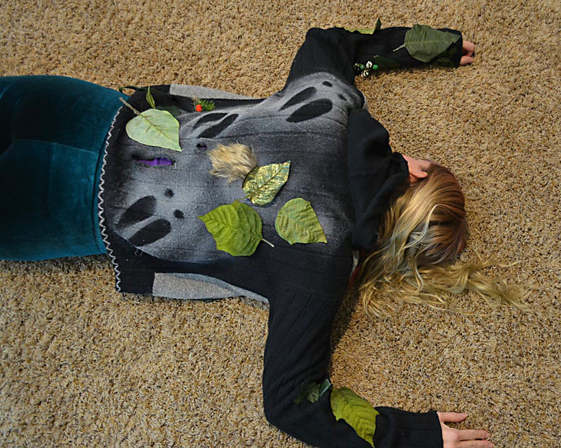 Woman Lays Down with Reindeer Tracks on Her Back for an Ugly Sweater Party | The Dating Divas