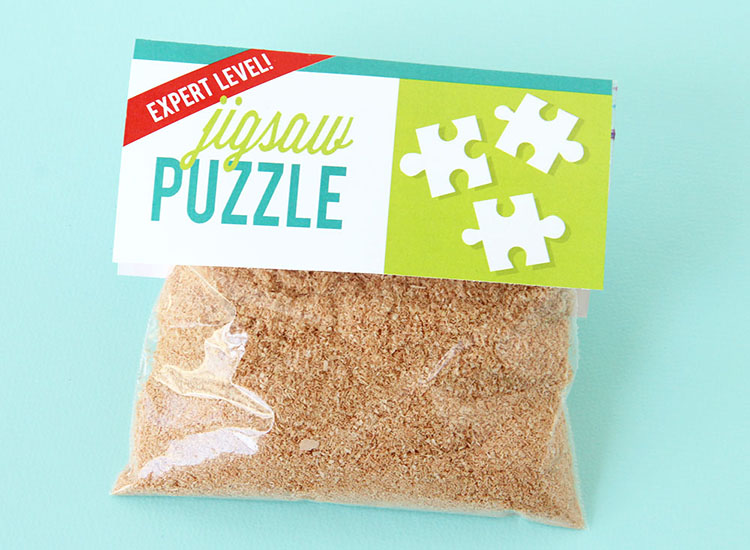 """Cheap gag gift idea for a white elephant party - a bag with sawdust and a """"jigsaw puzzle"""" label 