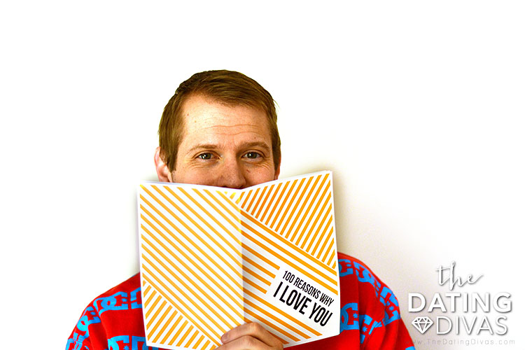 A man showing off his 100 Reasons Why I Love You Christmas gift   The Dating Divas