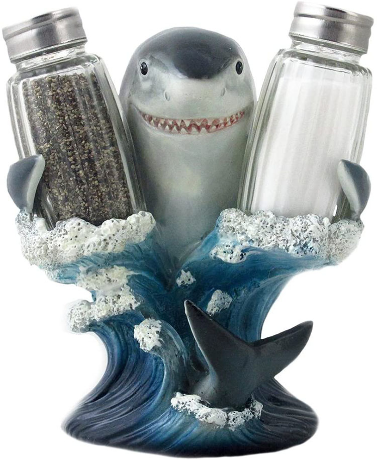 A shark figurine holds up a salt and a pepper shaker - a fun Christmas gag gift idea | The Dating Divas