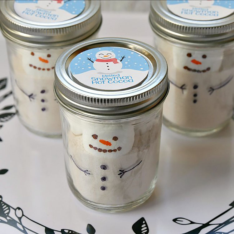 Creative Christmas gift idea of a jar with hot cocoa ingredients inside shaped like a snowman | The Dating Divas