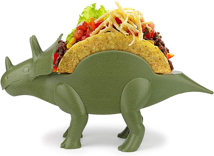 A dinosaur meant for holding tacos together at meal time - a funny gag gift for Christmas | The Dating Divas