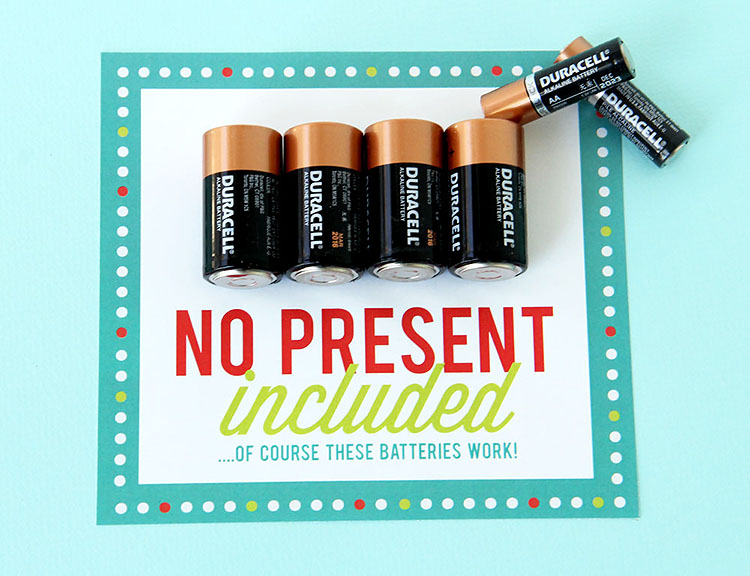 """Batteries glued to a label that says """"No present included"""" - a cheap white elephant gift for a Christmas party 
