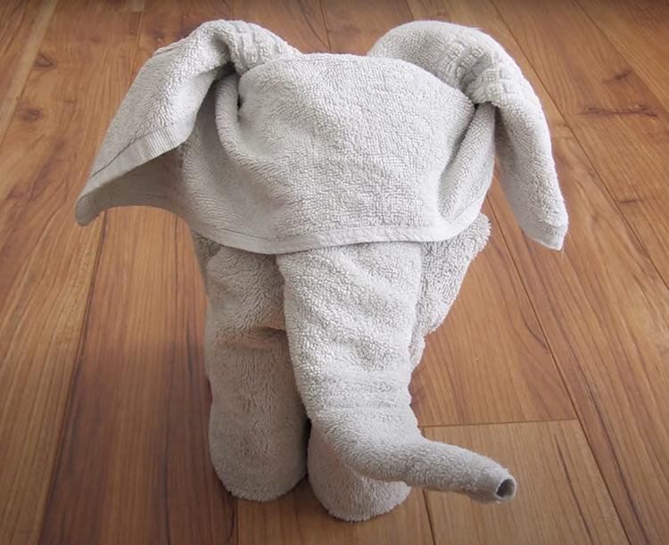 An elephant shaped-towel tutorial for a white elephant gift idea | The Dating Divas