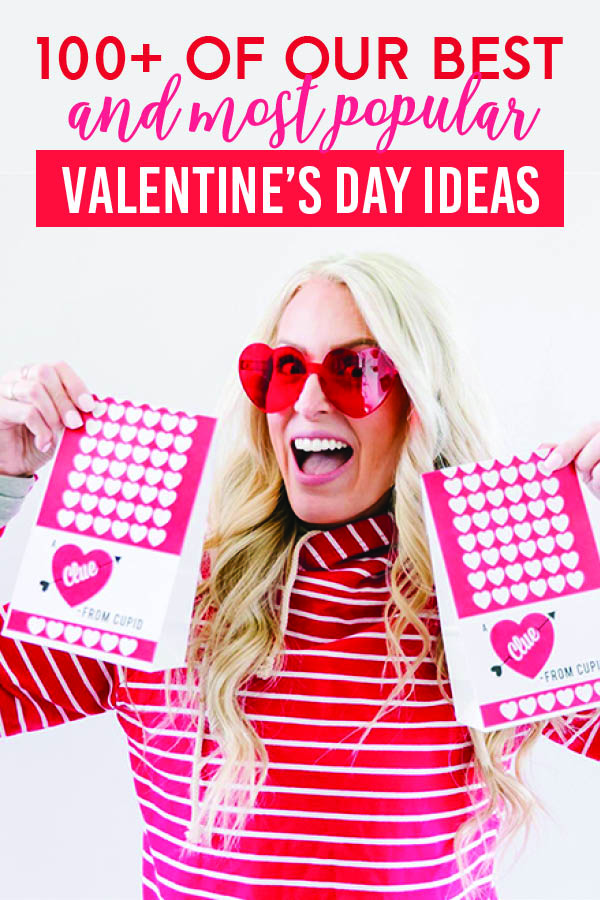 Wife holding a bag of Valentines Day scavenger hunt clues that are perfect for celebrating. | The Dating Divas