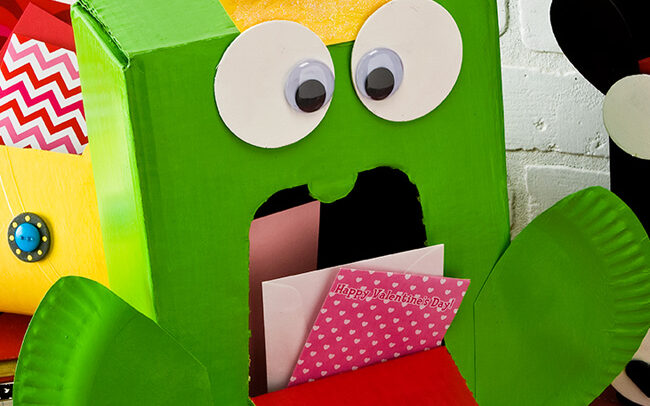 Bright green frog prince Valentine's Day craft made from a cardboard box | The Dating Divas