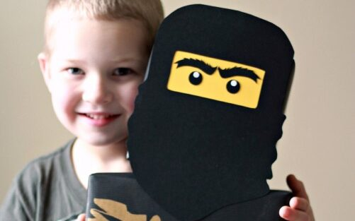 Little boy holding up Lego ninja themed Valentine's Day box | The Dating Divas