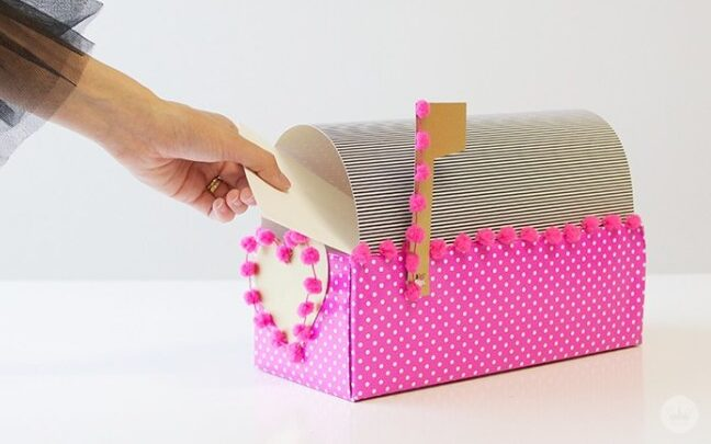Mini bright pink mailbox turned into a Valentine's Day box for cards | The Dating Divas