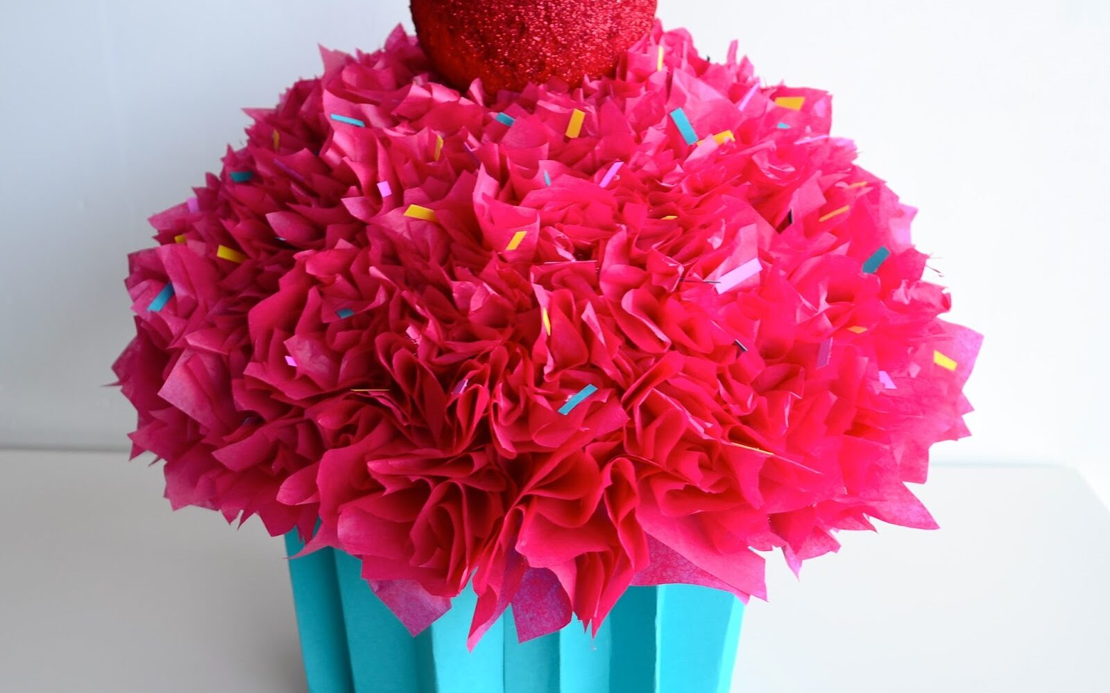 Bright pink Valentine's Day box cupcake with fluffy paper icing | The Dating Divas