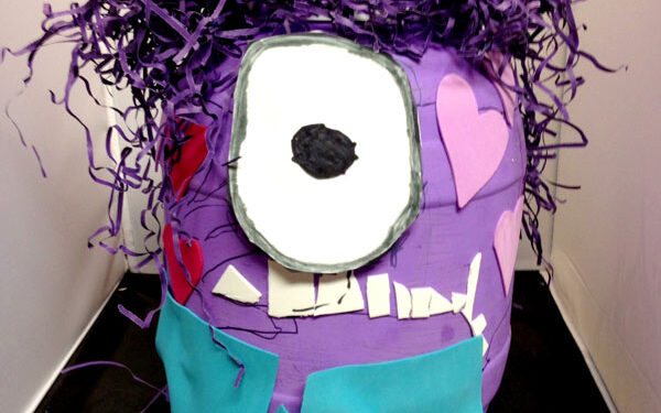 Bright purple Minion with crazy purple hair turned into a Valentine's Day box | The Dating Divas