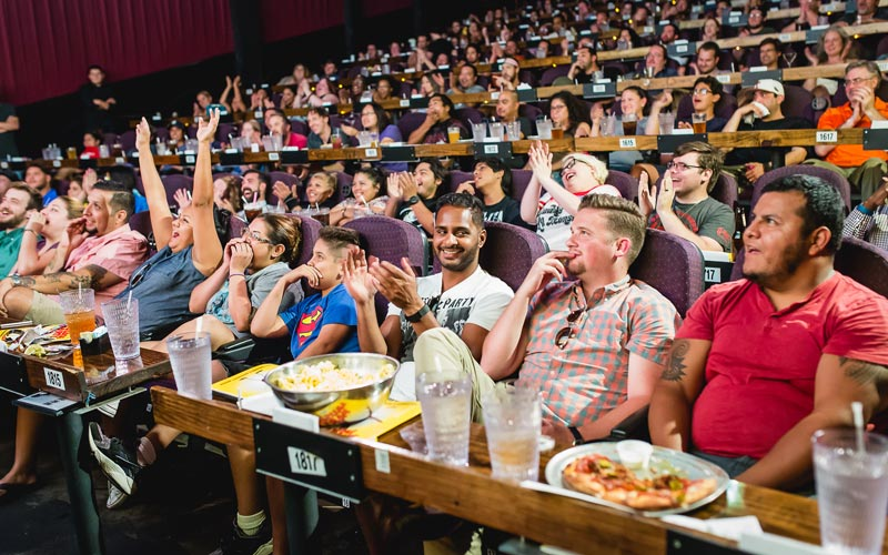 Audience loving their time at Alamo Drafthouse Cinema. | The Dating Diva