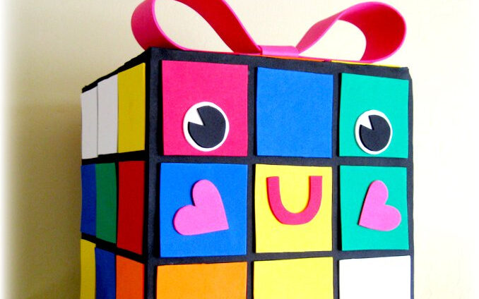 Rubiks cube box with pink bow on top | The Dating Divas
