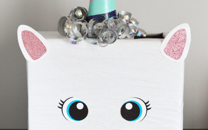 White unicorn valentines box with sparkly pink ears and bright blue eyes | The Dating Divas