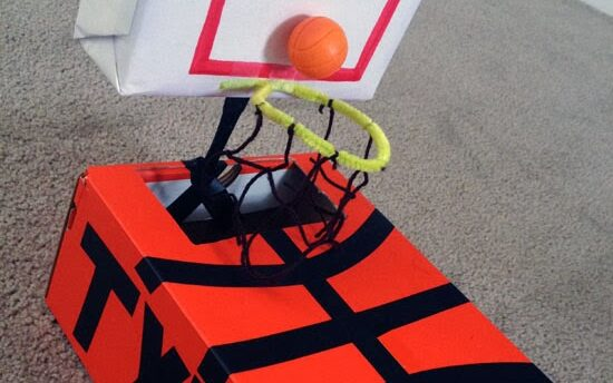 Bright orange box with a basketball hoop and personalized name on the side for Valentine's Day | The Dating Divas