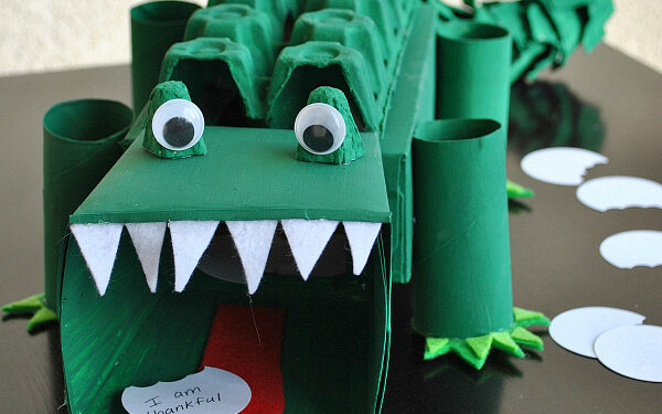 Dark green alligator made from an egg carton turned into a Valentine's Day box | The Dating Divas