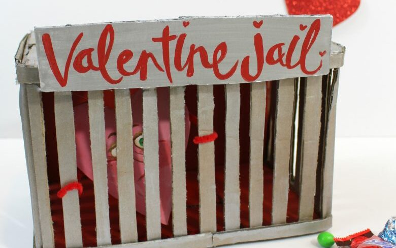 "A metallic box labeled ""Valentine Jail"" with a heart inside 