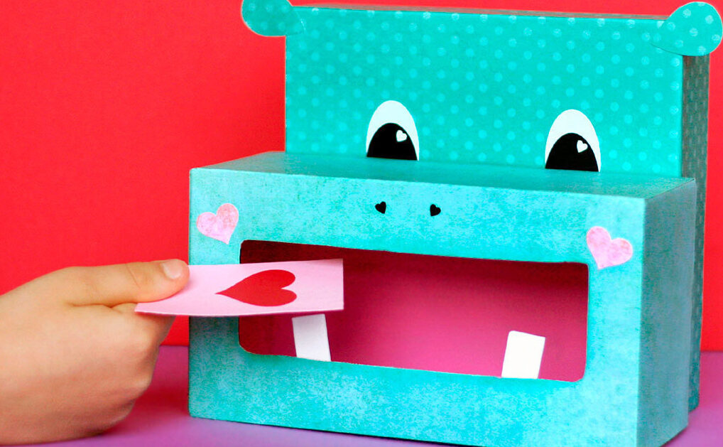 Bright blue hippo Valentine's Day box with a heart Valentine going inside | The Dating Divas