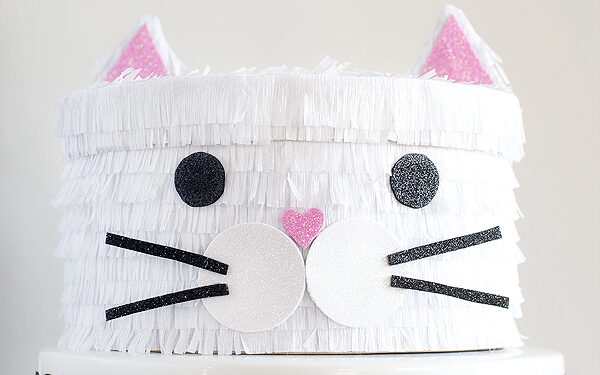 White kitty cat valentines box with sparkly pink ear | The Dating Divas