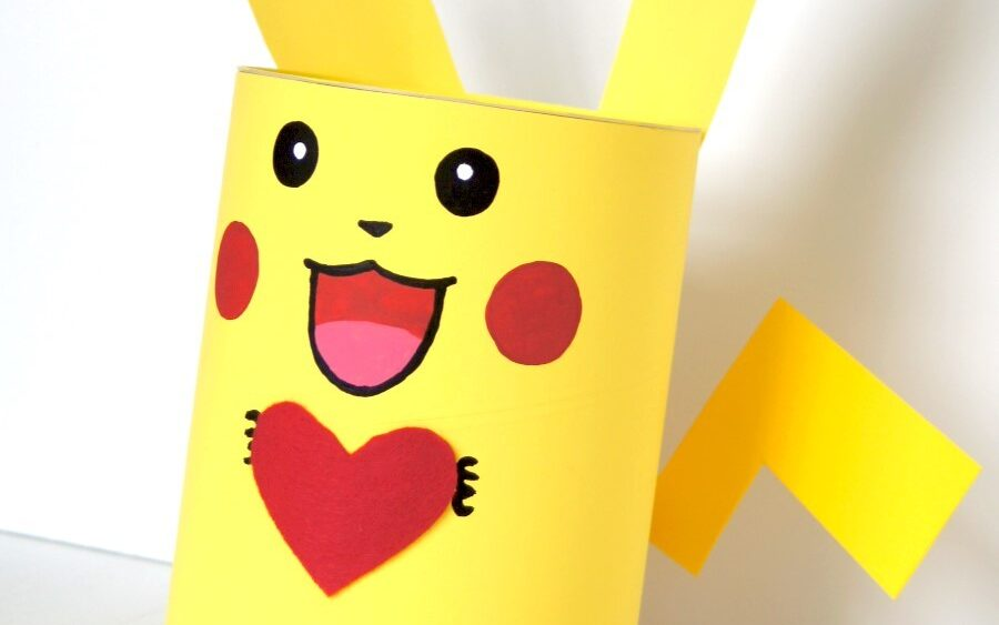 Bright yellow Pikachu valentine box holding a red heart | The Dating Divas