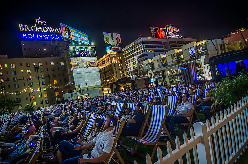 People having fun watching a movie on a rooftop | The Dating Diva