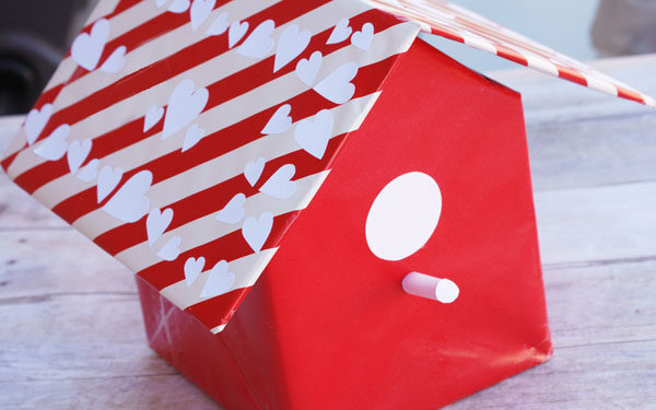 Red and white bird house with hearts on roof made for valentine cards | The Dating Divas