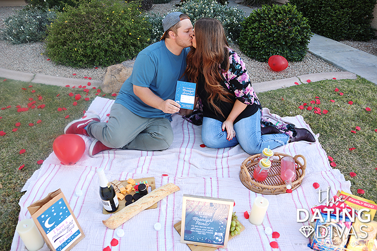 Wife and husband kissing on their scavenger hunt date | The Dating Divas