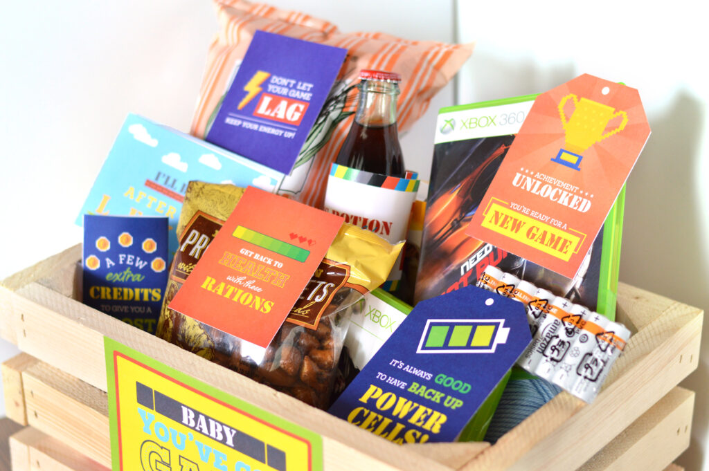 Wooden crate full of thoughtful gifts for men who like video games | The Dating Divas
