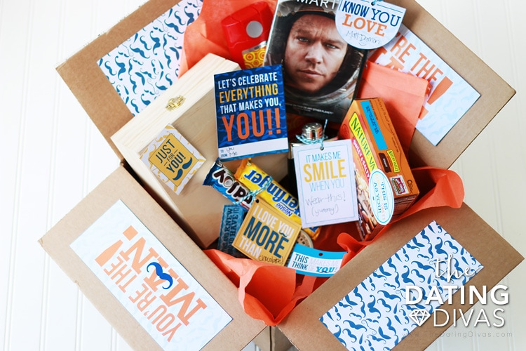 A cardboard box full of fun and thoughtful gifts all men love | The Dating Divas