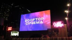 People having fun watching a movie on a rooftop   The Dating Diva