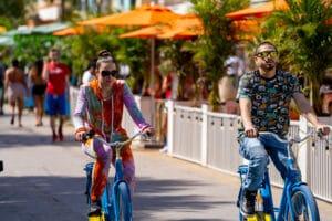 Couple enjoying biking with the Passage Bike Ride.   The Dating Diva