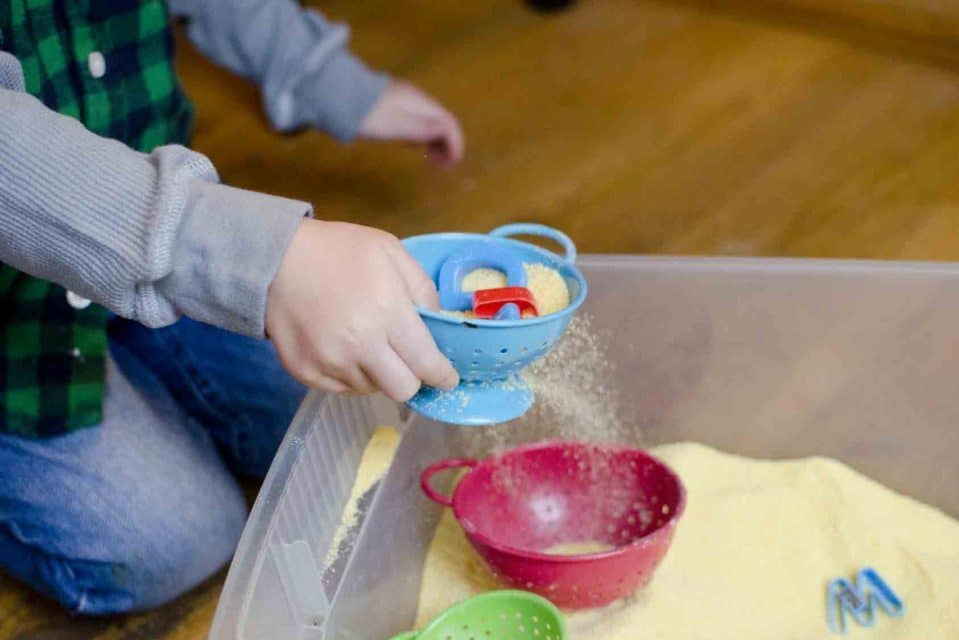 Sand sifting toddler activities | The Dating Divas