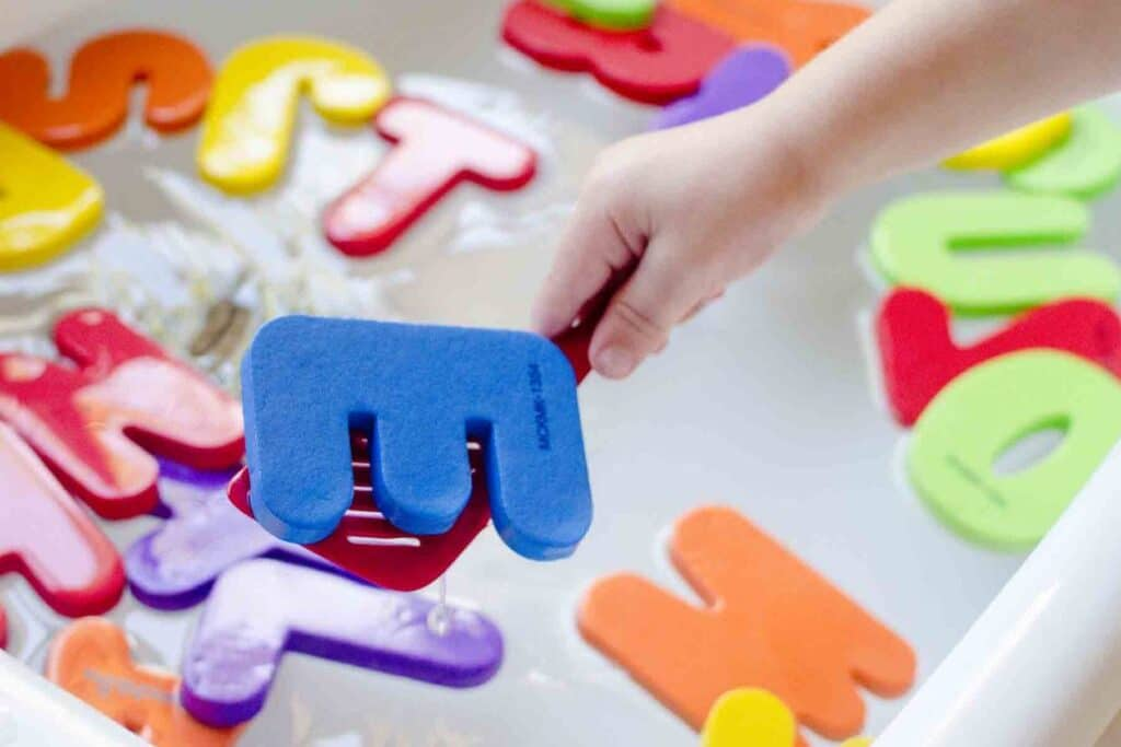Toddler activities using letters floating in water | The Dating Divas