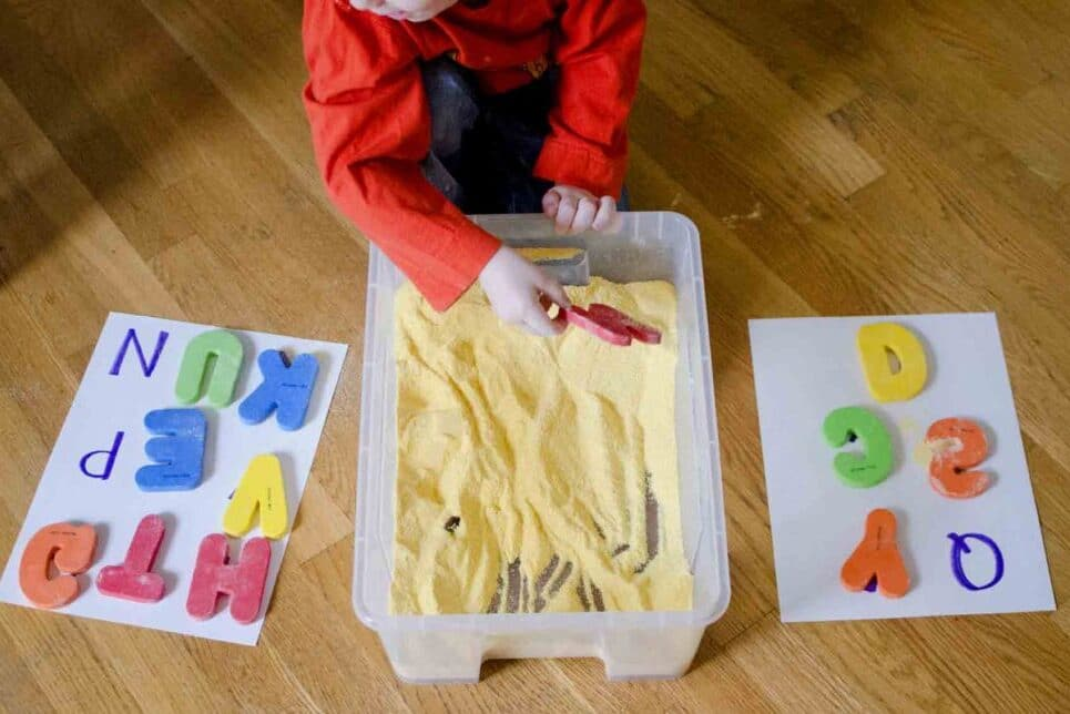 Sandbox letter hunt preschool activities at home | The Dating Divas
