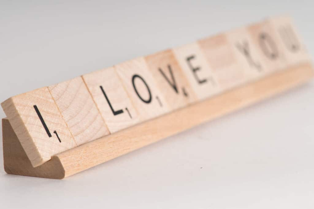 Scrabble blocks saying I Love You to spouse | The Dating Divas