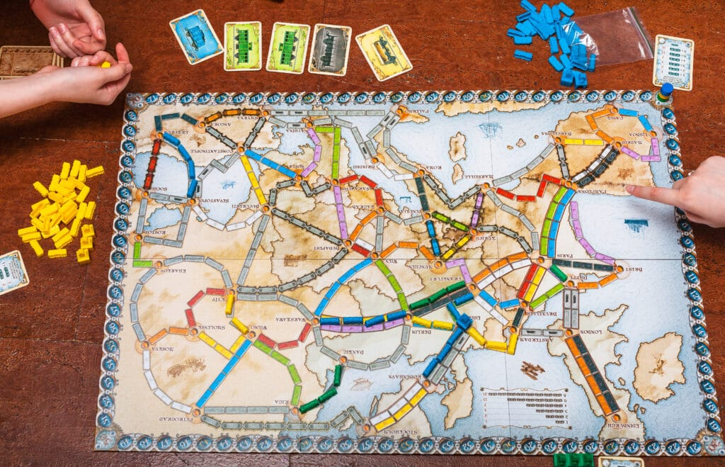 Couple playing Ticket To Ride - The Dating Divas