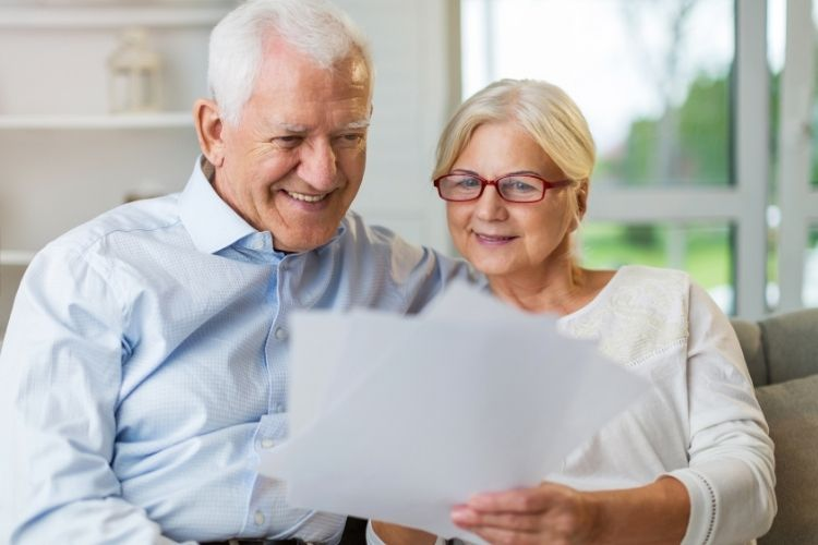 Older couple with Alzheimer's reading documents together   The Dating Divas