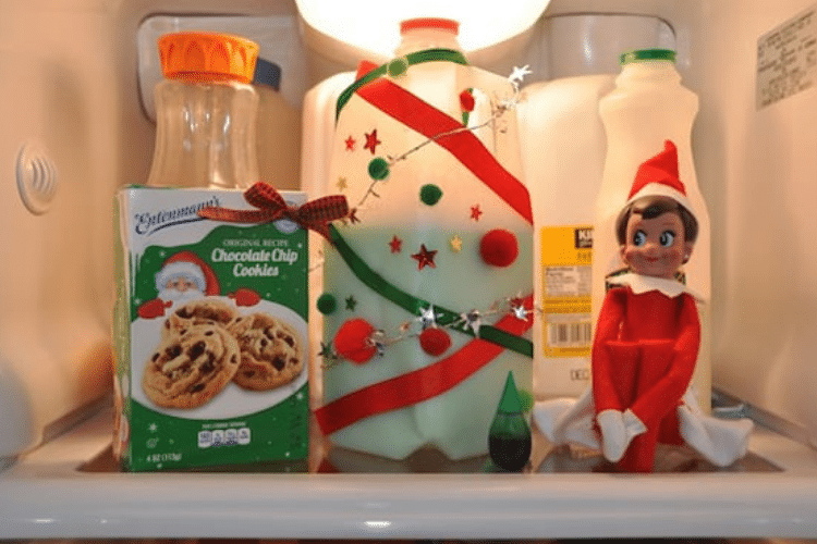 Elf on the shelf sits by some green-dyed milk   The Dating Divas