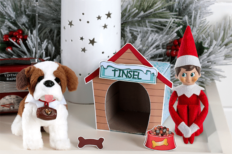 Elf on the shelf sitting with dog toy outside doghouse   The Dating Divas