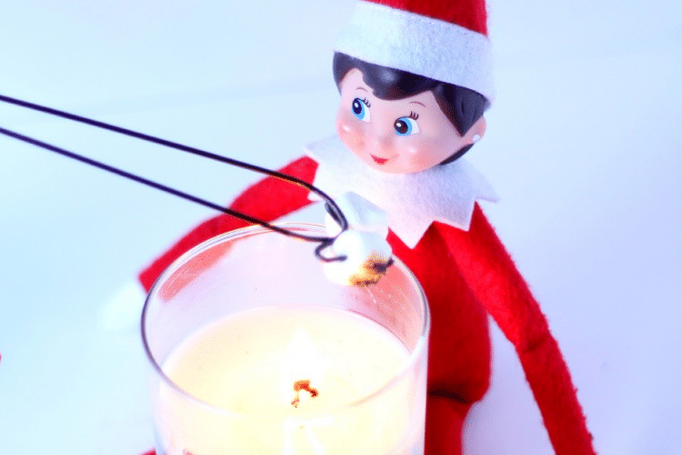 Elf on the shelf roasts s'mores by candlelight   The Dating Divas
