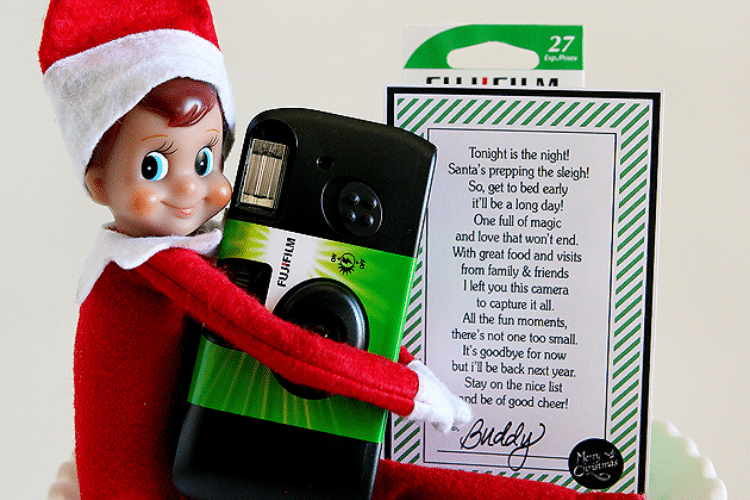 Elf on the shelf holding camera and goodbye note   The Dating Divas