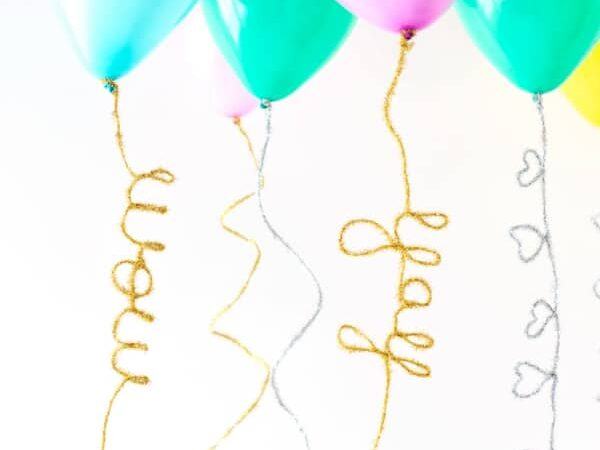 DIY bendable tails that can be added to balloons for birthday party decorations | The Dating Divas