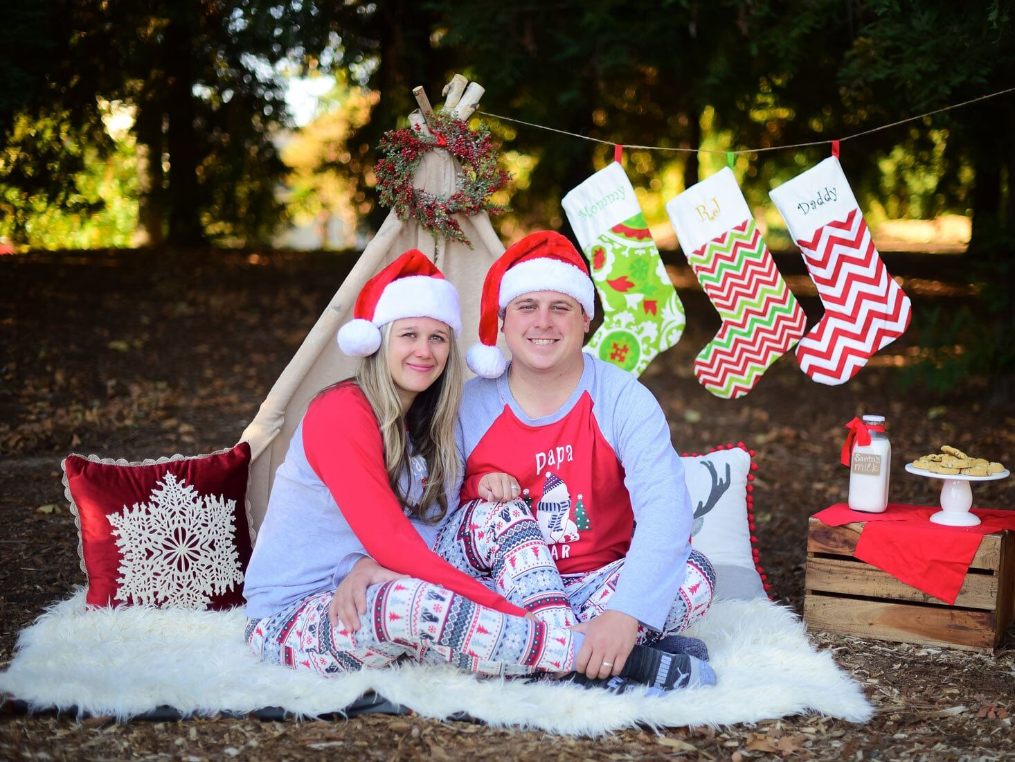 Christmas card ideas that take place outside in front of a tent | The Dating Divas