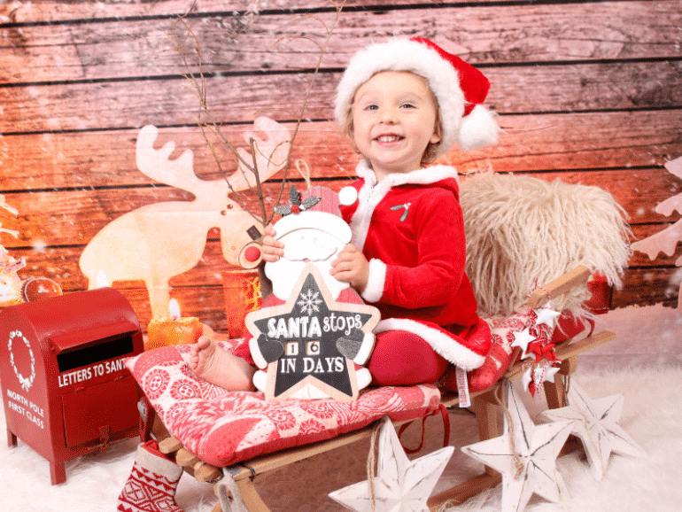 Family Christmas pictures that have a young child on a sleigh | The Dating Divas