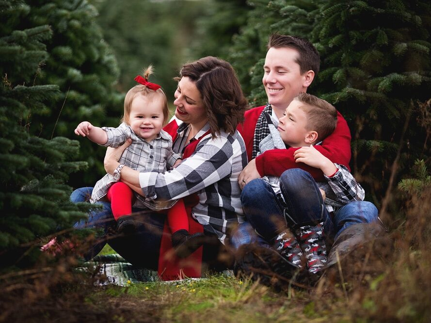 Family Christmas card ideas with black, white, and red outfits | The Dating Divas