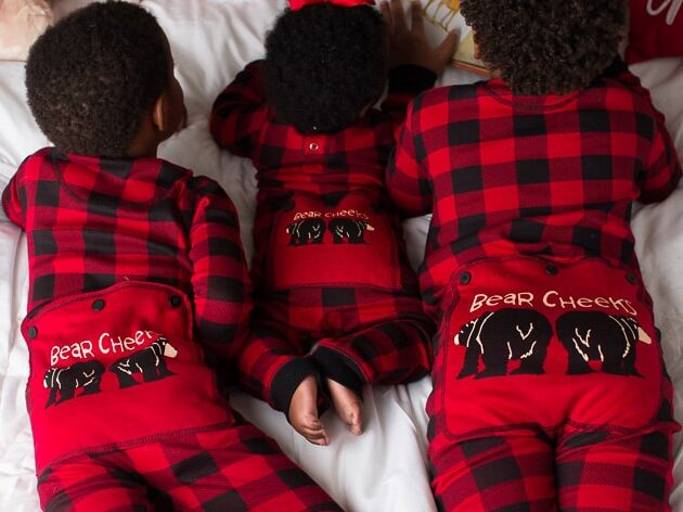 Christmas card ideas that show three siblings wearing magic Christmas pajamas | The Dating Divas