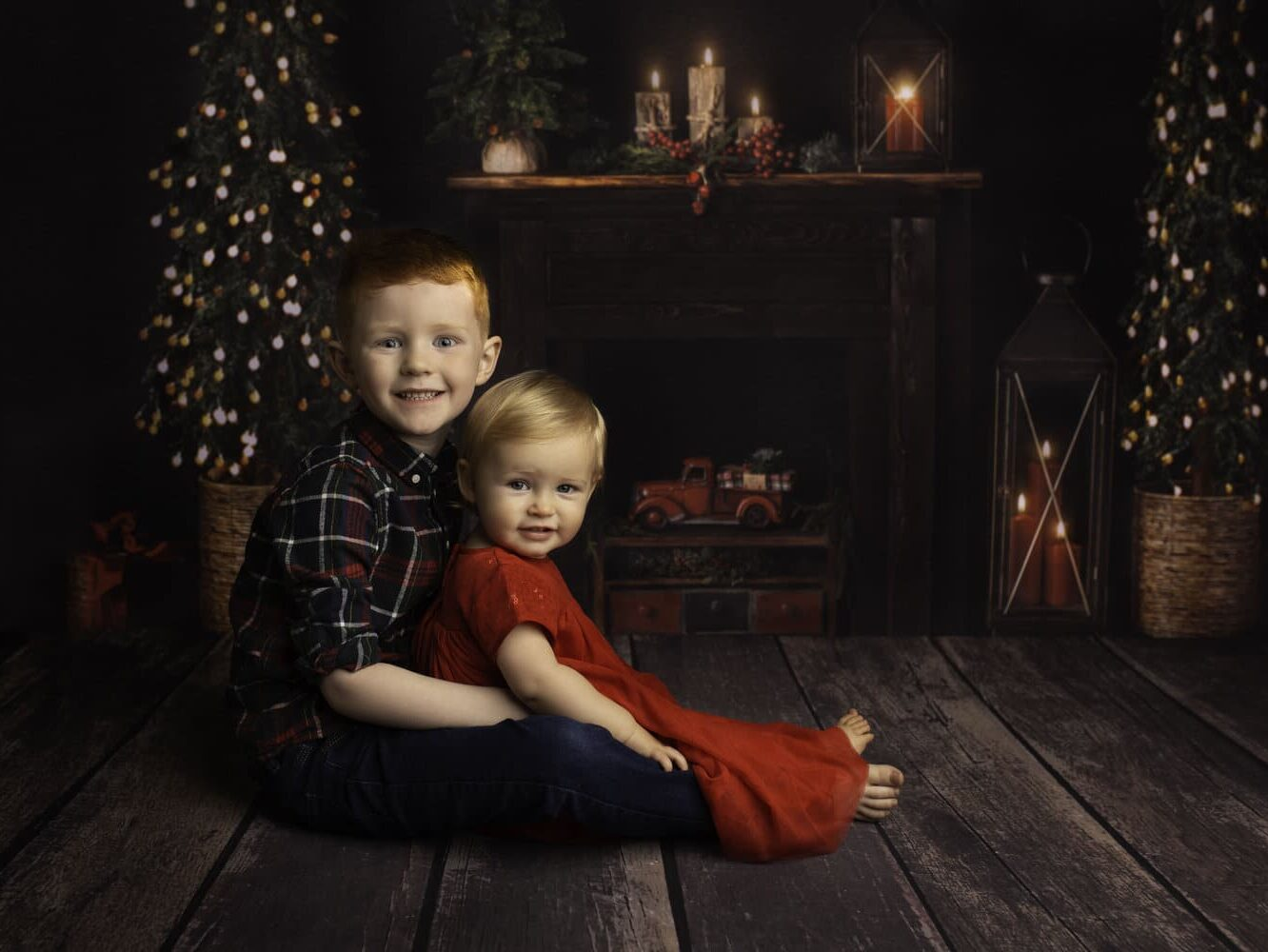 Family Christmas card ideas that have two kids in front of the fireplace | The Dating Dvas