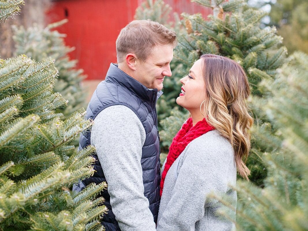 Romantic Christmas cards ideas for couples at a Christmas tree farm | The Dating Divas