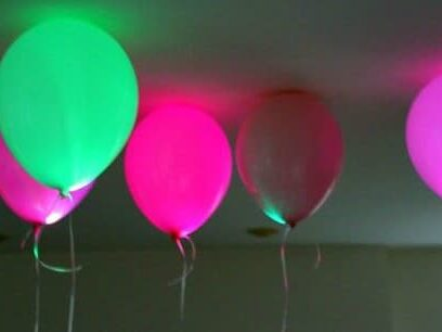 LED glow-in-the-dark balloons are a fun birthday decoration idea for an evening in the dark | The Dating Divas